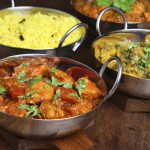 Curries in serving dishes