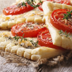 Traditional puff pastry with tomatoes, cheese and herbs